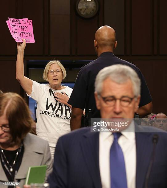 Code Pink for Peace members protest against US military action in Iraq before Defense Secretary Chuck Hagel testifies before the Senate Armed...