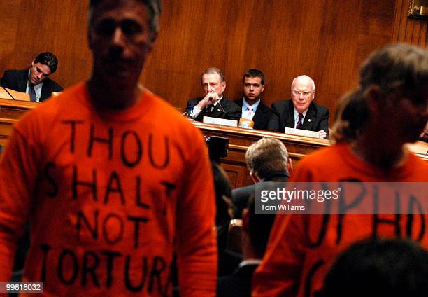 Code Pink member Steve Mihalis of Cleveland, and Veteran's for Peace member Leah Bolger of Oregon, stand with other members of their organization to...
