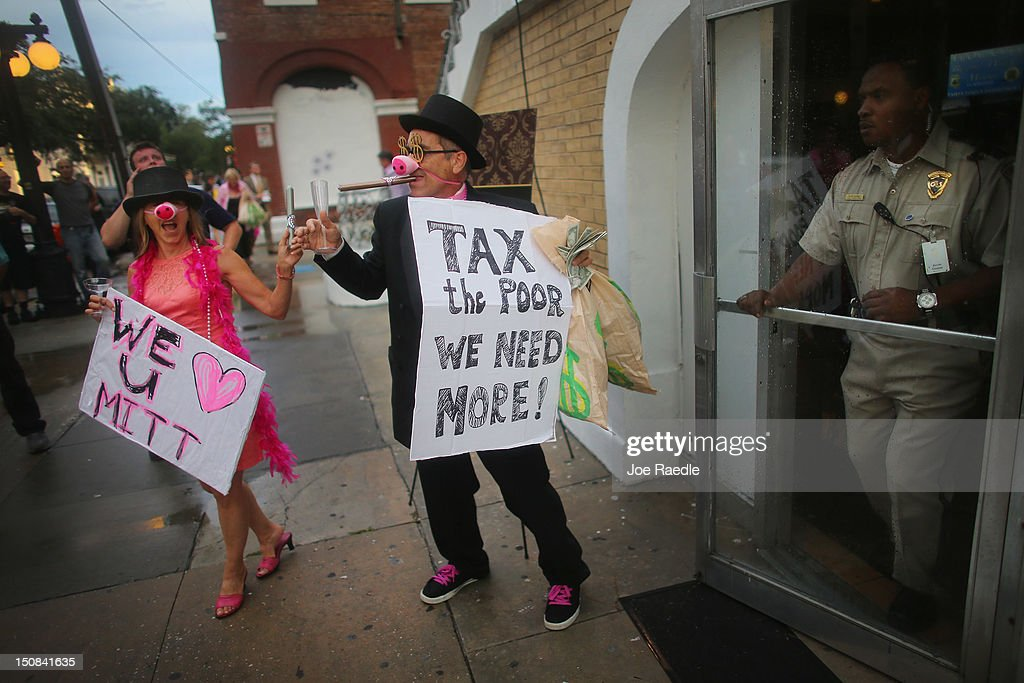 Code Pink protesters stand in front of Ybor City's Cuban Club which is reported to be hosting a party attended by U.S. Sen. Marco Rubio (R-FL), former Florida Governor Jeb Bush and others as the Republican National Convention is set to begin on August 27, 2012 in Tampa, Florida. The Code Pink demostrators were accusing the people attending the party of being rich as well as supporters of presumptive Republican presidential nominee, former Massachusetts Governor Mitt Romney.