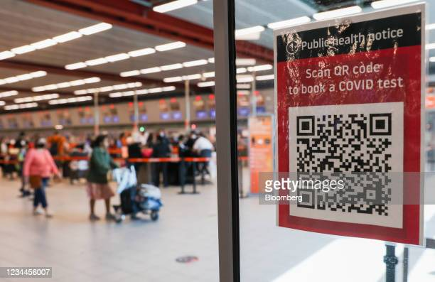 Code to book a Covid-19 test at London Luton Airport in Luton, U.K., on Wednesday, Aug. 4, 2021. The French government redoubled its efforts to get...