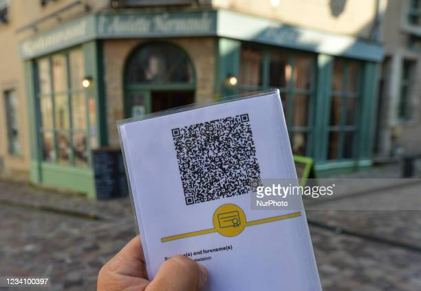 Code with EU COVID digital certificate displayed in front of a restaurant in Bayeux. On Wednesday, July 21 in Bayeux, Calvados, Normandy, France.