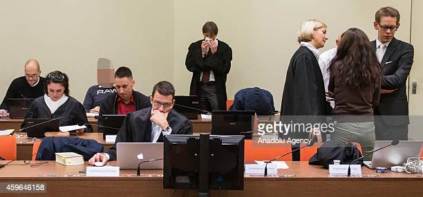 Codefendant Beate Zschaepe and her lawyers Wolfgang Heer and Anja Sturm and codefendants Carsten S Holger G and Ralf Wohlleben wait for the start of...