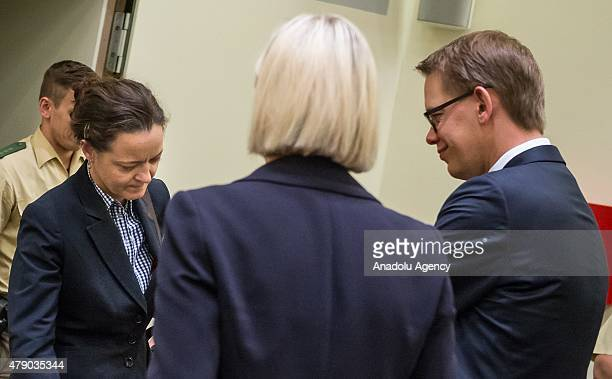 Codefendant Beate Zschaepe and her lawyers Wolfgang Heer and Anja Sturm arrive for another day of the NSU neoNazi murders trial on June 30 2015 in...