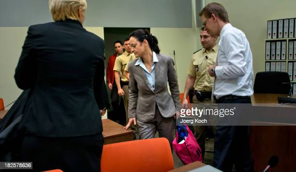 Codefendant Beate Zschaepe arrives for another day of the NSU neoNazi murders trial on October 1 2013 in Munich Germany Among those scheduled to...