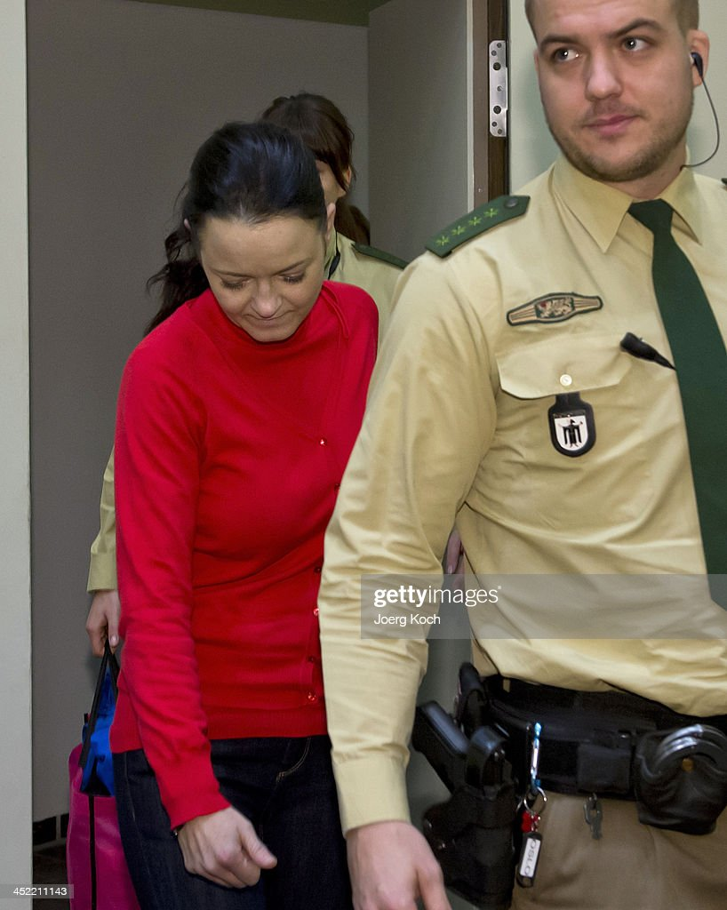 Co-defendant Beate Zschaepe arrives for today's NSU neo-Nazi murders trial, in which Zschaepe's mother and other witnesses will testify in the witness stand (front) on November 27, 2013 in Munich, Germany. Zschaepe is accused of assisting neo-Nazis Uwe Mundlos and Uwe Boehnhardt in their eight-year murder spree that targeted nine immigrants and one policewoman.