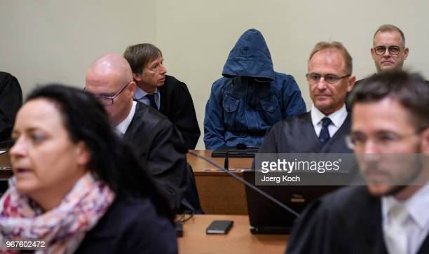 Codefendant Carsten S and main defendant Beate Zschaepe arrive for the trial on terror charges in connection with the neoNazi NSU group at the...