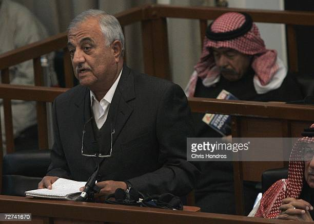 Codefendant Sabir alDouri speaks to court while Ali Hassan alMajid looks at notes during the 'Anfal' trial on December 6 2006 in Baghdad Iraq The...