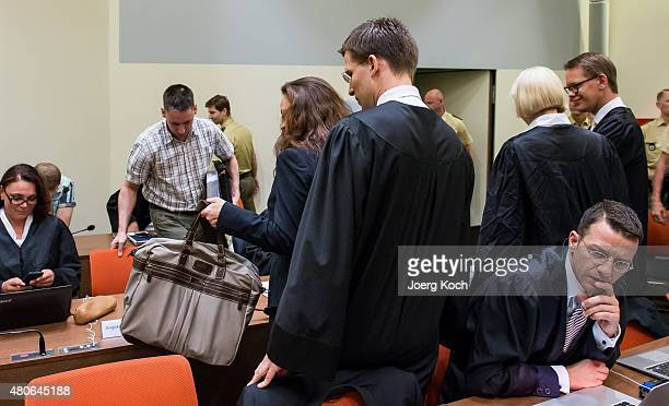 Codefendants Beate Zschaepe and Ralf Wohlleben her new lawyer Mathias Grasel and her other lawyers Wolfgang Heer Wolfgang Stahl and Anja Sturm wait...