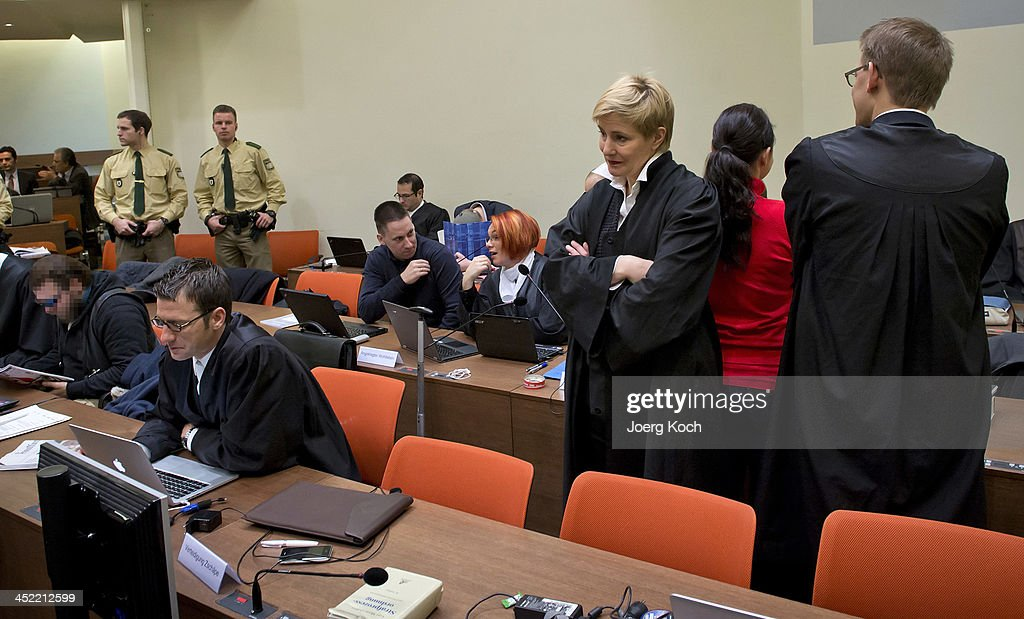The identity of one of the people (far left) in this image has been obscured at the request of the court.) Co-defendants Beate Zschaepe (2nd-R), Andre E., Ralf Wohlleben (2nd-row-L) and Holger G. (3rd -row) wait for beginning of todays NSU neo-Nazi murders trial, in which Zschaepe's mother and other witnesses will testify today on November 27, 2013 in Munich, Germany. Zschaepe and the others are accused of assisting neo-Nazis Uwe Mundlos and Uwe Boehnhardt in their eight-year murder spree that targeted nine immigrants and one policewoman.