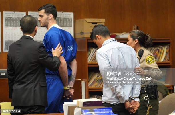 Codefendants Zachary Frank Leets left and Luis Samaniego Barajas are taken out of court in handcuffs after they were sentenced to four years in...