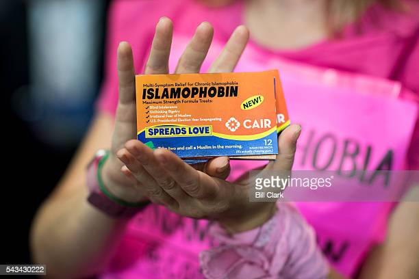 "CodePink activist hands out ""Islamophobin"" pills to fight Islamaphobia before the start of Sen. Ted Cruz' hearing in the Subcommittee on Oversight,..."