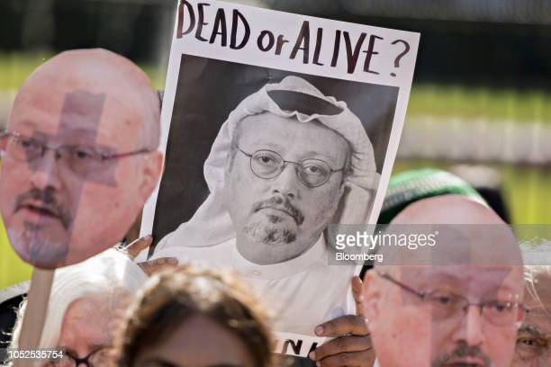 Codepink demonstrators hold photographs of journalist Jamal Khashoggi outside the White House in Washington DC US on Friday Oct 19 2018 President...