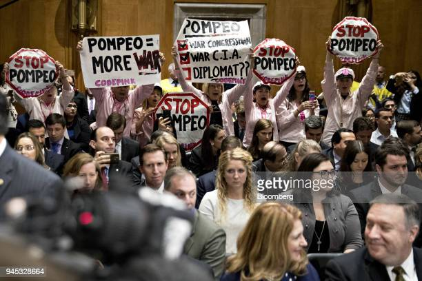 Codepink demonstrators hold up signs opposed to Michael Pompeo director of the Central Intelligence Agency and US secretary of state nominee for...