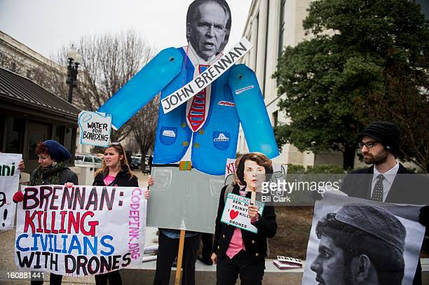 CodePink holds a protest against the nomination of John Brennan to be director of the Central Intelligence Agency outside of the Dirksen Senate...