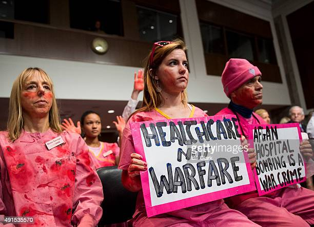 CodePink protesters hold signs about the Doctors Without Borders hospital bombing as General John F Campbell Resolute Support Mission Commander in...