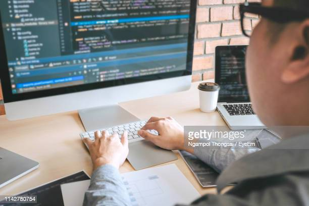 Coder Coding In Computer At Office