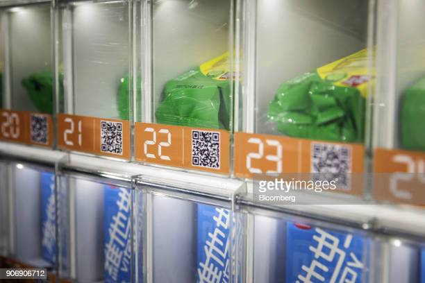 QR codes are displayed on a vending machine at Tencent Holdings Ltd's WeChat Open Class Pro conference in Guangzhou China on Monday Jan 15 2018...