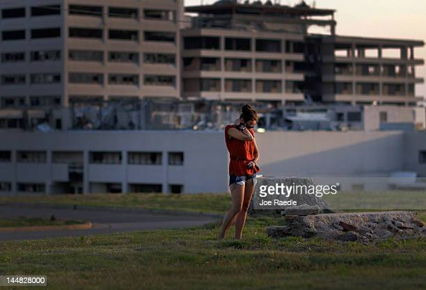 Codessa Schoonover cries next to what remains of her grandmother's home after she was killed when a tornado struck almost one year ago on May 19 2012...