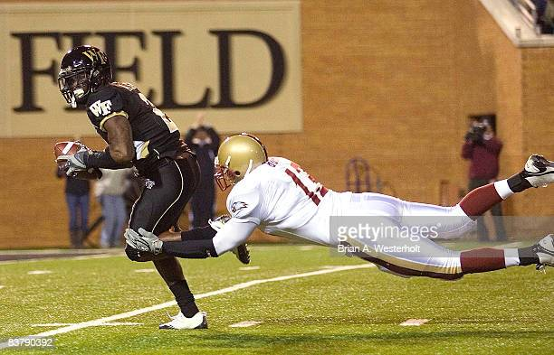 Codi Boek of the Boston College Eagles tackles Alphonso Smith of the Wake Forest Demon Deacons after Smith had recovered a block punt at BB&T Field...