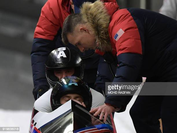 US Codie Bascue and US Samuel Mc Guffie look on after the 2man bobsleigh heat 1 run during the Pyeongchang 2018 Winter Olympic Games at the Olympic...
