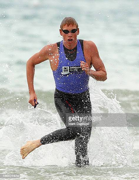 Codie Grimsey of Brisbane comes up out of the water on his way to winning the Open Male section of the 2012 Pier to Pub on January 7 2012 in Lorne...