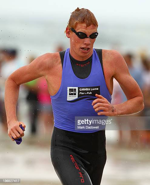 Codie Grimsey of Brisbane races up to the finishing gates on his way to winning the Open Male section of the 2012 Pier to Pub on January 7 2012 in...