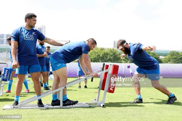Codie Taylor, Dane Coles and Liam Coltman of the All Blacks run through drills during a New Zealand All Blacks Rugby World Cup Training Session at...