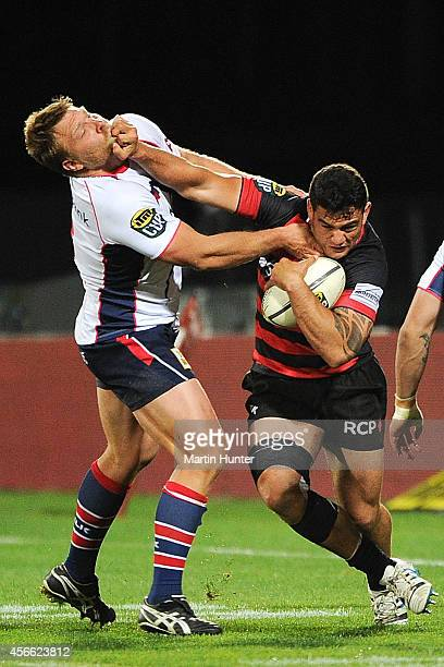 Codie Taylor of Canterbury fends off Ross Geldenhuys of Tasman during the ITM Cup match between Canterbury and Tasman at AMI Stadium on October 4...
