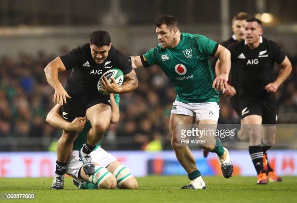 Codie Taylor of New Zealand All Blacks evades Cian Healy and during the international friendly between Ireland and New Zealand at Aviva Stadium on...