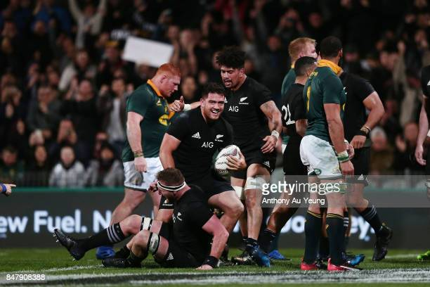 Codie Taylor of the All Blacks celebrates with teammates after scoring a try during the Rugby Championship match between the New Zealand All Blacks...
