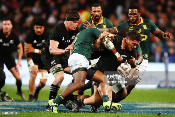 Codie Taylor of the All Blacks charges forward during the Rugby Championship match between the New Zealand All Blacks and the South African...