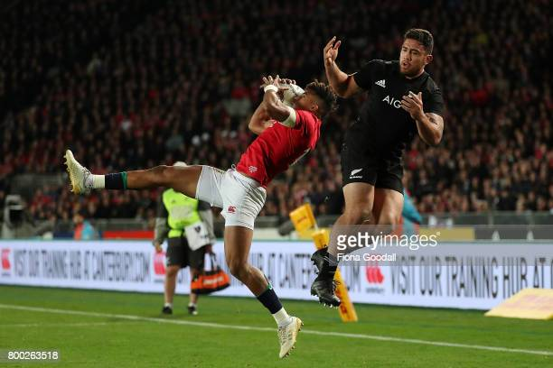 Codie Taylor of the All Blacks goes for the high ball with Anthony Watson of the Lions during the Test match between the New Zealand All Blacks and...