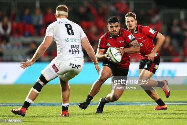 Codie Taylor of the Crusaders attempts to evade Daniel du Preez of the Sharks during the round 12 Super Rugby match between the Crusaders and Sharks...