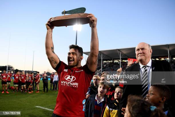 Codie Taylor of the Crusaders celebrates with the trophy after winning the round 9 Super Rugby Aotearoa match between the Crusaders and the...