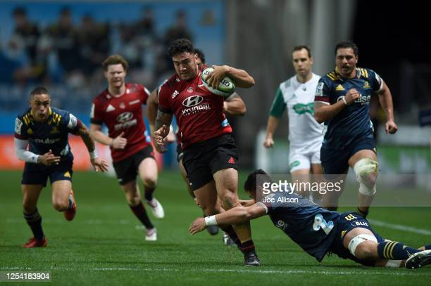 Codie Taylor of the Crusaders charges forward during the round 4 Super Rugby Aotearoa match between the Highlanders and the Crusaders at Forsyth Barr...