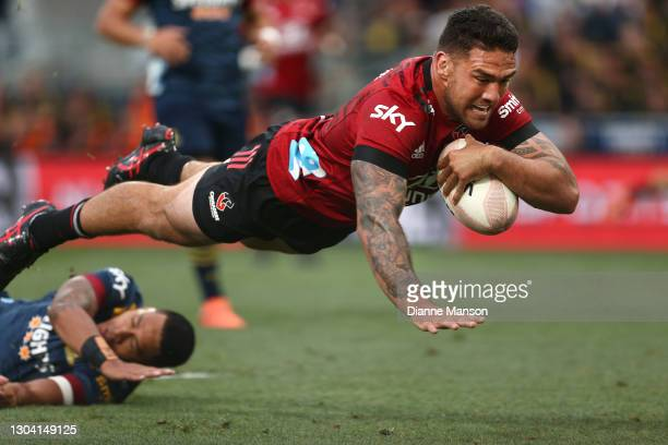 Codie Taylor of the Crusaders dives over to score a try during the round one Super Rugby Aotearoa match between the Highlanders and the Crusaders at...