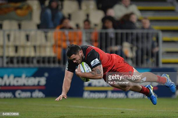 Codie Taylor of the Crusaders dives over to score a try during the round 16 Super Rugby match between the Crusaders and the Rebels at AMI Stadium on...