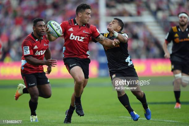Codie Taylor of the Crusaders is tackled by Te Toiroa Tahuriorangi of the Chiefs during the round four Super Rugby match between the Crusaders and...