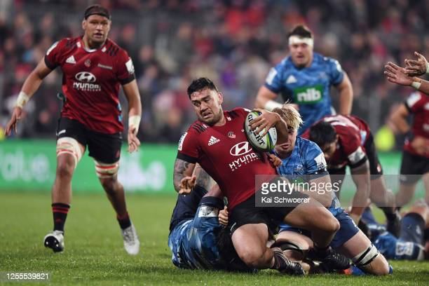 Codie Taylor of the Crusaders is tackled during the round 5 Super Rugby Aotearoa match between the Crusaders and the Blues at Orangetheory Stadium on...