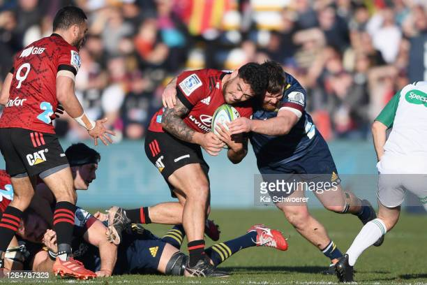 Codie Taylor of the Crusaders is tackled during the round 9 Super Rugby Aotearoa match between the Crusaders and the Highlanders at Orangetheory...