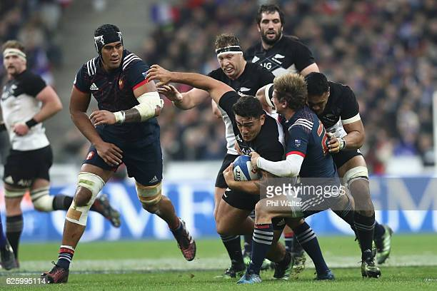 Codie Taylor of the New Zealand All Blacks is tackled during the international rugby match between France and New Zealand at Stade de France on...