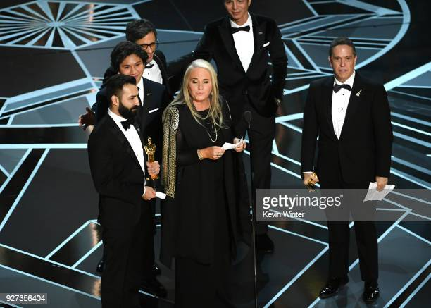 Codirector Adrian Molina actors Anthony Gonzalez Gael Garcia Bernal and Benjamin Bratt producer Darla K Anderson and director Lee Unkrich accept Best...