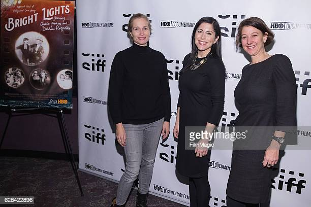 CoDirector Alexis Bloom KOMO TV Reporter Lindsay Cohen and SIFF Executive Director Sarah Wilke arrive at the Seattle Premiere of the HBO Documentary...
