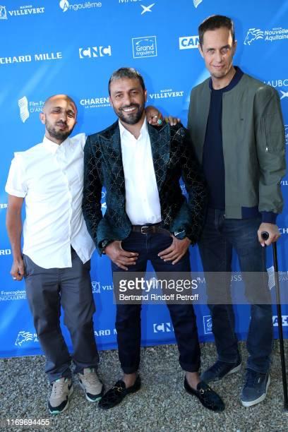 CoDirector Mehdi Idir CoProducer JeanRachid Kallouche and CoDirector Grand Corps Malade aka Fabien Marsaud attend the Photocall of the movie La Vie...