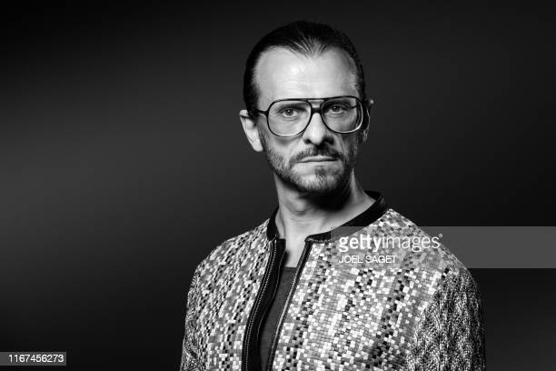 Co-director of contemporary art gallery 'Galleria Continua' Lorenzo Fiaschi poses during a photo session in Paris on September 11, 2019. - The...
