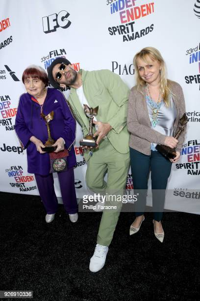 Codirectors JR and Agnes Varda and producer Rosalie Varda winners of Best Documentary for 'Faces Places' pose in the press room during the 2018 Film...