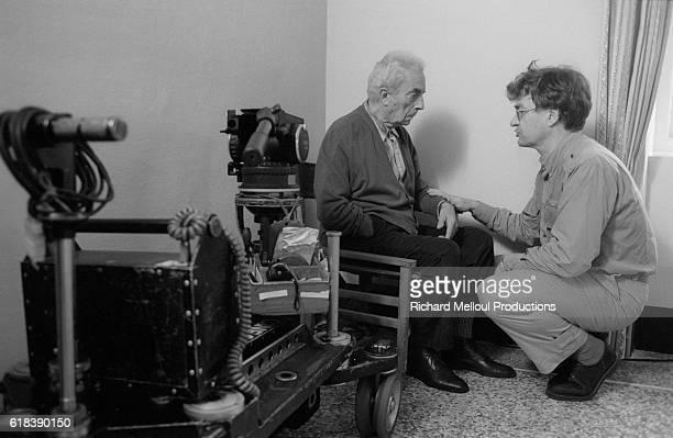 Co-directors Michelangelo Antonioni and Wim Wenders talking on the set of the Franco-Italian-German film Al di la delle Nuvole . The film, based on a...