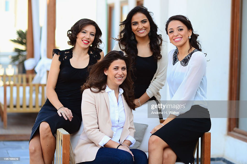 Co-Directors Shannon Farhoud (Standing C) with (Sitting) Ashlene Ramadan (L), Melanie Fridgant (C) and Rana Khaled of 'Lyrics Revolt' poses for a portrait during the 2012 Doha Tribeca Film Festival at the AL Najada Hotel on November 20, 2012 in Doha, Qatar.