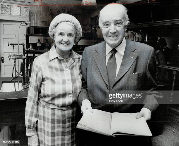 Codiscoverer of insulin Dr Charles H Best and his wife look over notes last night he and Sir Frederick Banting compiled during their reseach They're...