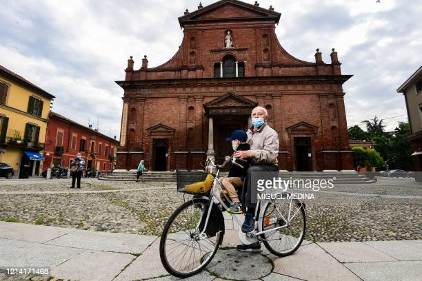 Codogno resident and 74-year-old pensioneer, Giancarlo Barcellesi poses on his bicycle outside the San Biagio and Santa Maria Immacolata church on...